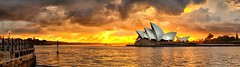 Opera's Inferno (Tim Poulton) Tags: ocean city sky seascape reflection building nature water clouds sunrise landscape 50mm nikon theatre harbour wide sydney australia landmark tourist panoramic nsw operahouse cloudscape carlziess d3x zf2