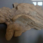 Terracotta plaque of a winged figure thumbnail