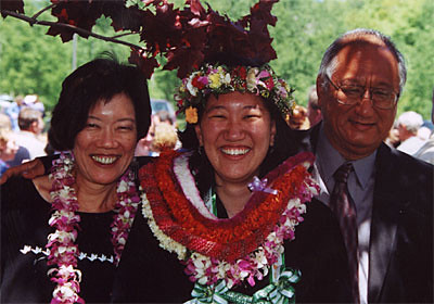 Graduate Malia Tanji Poses with Her Parents Following Commencement.