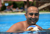 Always happy in the Pool (Meshari Al-Rezaihan) Tags: blue friends vacation portrait people holiday pool smile canon ball swimmingpool 550d sharmelshaikh meshari lens18200mm eos550d alrezaihan