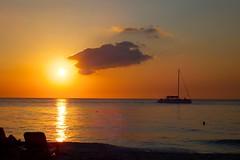 Sunset in Negril/Jamaica (picaddict) Tags: sunset sea sun strand meer sonnenuntergang jamaica sonne reflexion segelschiff negril refection sailer klippenspringer