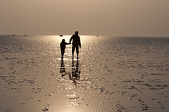 Morning walk at Chandipur Beach, Orrisa,India. (Tapas Biswas) Tags: morning sea people india beach silhouette festival children nikon women child walk candid horizon father streetlife bengal morningwalk westbengal fatherson d90 chath nikond90 silhouetteart