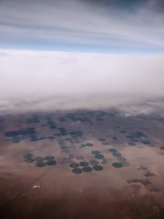 Crops in the desert (Lastien) Tags: above travel sky usa clouds plane phone desert earth crops birdseyeview motorolag