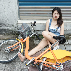 The Incident: inspired by photographer Mark Wilkinson (I C E I N N) Tags: portrait people orange white girl bike bicycle yellow metal wall 35mm asian concrete gate moody photoshoot accident outdoor top sony sneakers jeans tiles e angry overalls denim fe  adidas  incident gaze f28 trainer unlucky  carlzeiss ubike emount sonnartfe2835 femount sonya7ii ilce7m2
