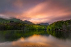 Faith and Hope (Blai Figueras) Tags: longexposure trees sunset sky panorama sun lake mountains water fog clouds reflections landscape atardecer agua rboles flickr horizon atmosphere paisaje le cielo eden paraiso reflejos montaas silkeffect
