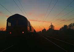 Belford -  Distant Sunset (Gilli8888) Tags: belford northumberland railway sunset train loco locomotive class66 track railwaylines railscape overheads powerlines silhouette dusk twilight