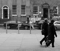 The waiting (David Bergin Photography) Tags: ireland streetphotography passing city kilkenny nikond3000 blackandwhite people walking street taxi taxirank