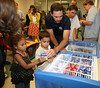 JIMMIE JOHNSON passing out ice cream at Speediatrics Visit