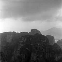 058559 03 (ndpa / s. lundeen, archivist) Tags: blackandwhite bw cliff mountains 6x6 tlr monochrome rock clouds mediumformat greek blackwhite sandstone europe nick pillar may rocky cliffs greece 1950s pillars 1959 meteora outcropping dewolf triptoeurope kalabaka thessaly centralgreece stonepillar thessalia outcroppings nickdewolf photographbynickdewolf stonepillars metora