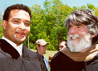 Graduate Kermit Woods Talks with Ceramics Professor Michael Boylen After Commencement.