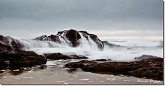 over the rock (liipgloss) Tags: ocean longexposure sea water rock sunrise canon newcastle flow sand australia nsw 1740l cavesbeach 5dii