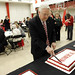 Chancellor Woodson cuts the cake at employee appreciation festivities.