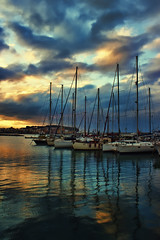 Sailers at sunset (Theophilos) Tags: sunset sea sky reflection clouds marina crete rethymno sailers