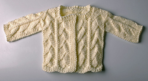 Ravelry: Dragon Skin Baby Sweater pattern by Lara Neel