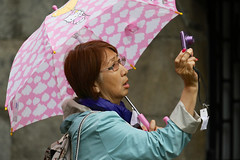 Hello Kitty (zsnajorrah) Tags: madrid camera pink people urban woman umbrella spain purple candid mint streetphotography raincoat unaware ef70200mmf4lis 7dmarkii
