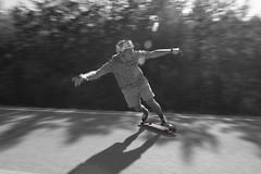 B&W Longboarding (ParkerTownes) Tags: red bw white black sports canon skateboarding action longboard panning longboarding