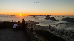 Looking at the first rays | @Mirante Dona Marta, #RiodeJaneiro, #Brazil (Jos Eduardo Nucci) Tags: world blue autumn friends sky people favorite seascape mountains colour southamerica nature riodejaneiro digital start sunrise photography hope dawn lights landscapes daylight twilight nikon warm soft flickr cityscape rj friendship time sweet coconut shots horizon wide dream cream adorable silhouettes atmosphere nebula harmony passion tropical getty hugs rays paths reach oceans lovely surrounded likes magichour carioca blessed cableway shinning discover d800 olympicgames vibe guanabarabay 2016 mesmerize mirantedonamarta botafogobeach wonderfulcity 1424mm instagram joseduardonucci