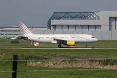 EC-KMI leaving. (aitch tee) Tags: aircraft airbus takeoff airliner a320 walesuk cardiffairport vueling eckmi maesawyrcaerdydd cwlegff