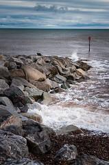 Breakwater (linco100) Tags: ocean uk greatbritain sea england beach water warning coast rocks waves unitedkingdom britain pebbles southcoast groyne breakwater seadefences jurassiccoast