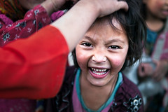 Laughter. Turtuk, India (Marji Lang Photography) Tags: life travel portrait people india playing smile face childhood smiling horizontal closeup kids youth laughing children fun happy photography kid funny asia child emotion expression indian teeth colorphotography documentary yay laugh innocence grin expressive laughter emotional playful himalayas oneperson biggrin ladakh onechild travelphotography ladakhi jammuandkashmir traveldestination marjilang