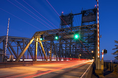 Southbound Interstate Bridge (Curtis Gregory Perry) Tags: longexposure bridge blue light sky motion blur green cars car night vancouver washington nikon highway traffic streak 5 five south trail drawbridge interstate stoplight signal d800e