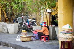 Vietnamese woman selling food on the street of Hoi An (Evgeny Ermakov) Tags: street city travel summer people food woman color tourism bike bicycle asian daylight town corn asia southeastasia vietnamese sitting market culture sunny vietnam hoian potato trading vendor daytime pancake southeast selling bake streetfood touristic potatopancake