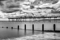 bw589 (Nadia Isakova) Tags: uk longexposure trip travel sea vacation blackandwhite bw tourism beach monochrome horizontal landscape mono coast pier town blackwhite seaside spring holidays europe unitedkingdom britain piers sightseeing devon beaches april destination coastline british leisure towns groyne westerneurope groynes teignmouth northerneurope traveldestinations nadiaisakova
