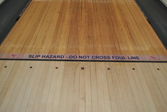 SLIP HAZARD - DO NOT CROSS FOUL LINE