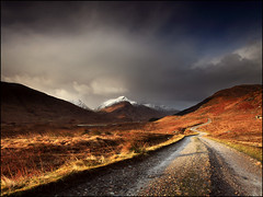 Sunshowers Loch Arkaig (angus clyne) Tags: road morning travel light cloud mountain lake holiday snow storm west fall river shower dawn drive climb scotland spring highlands day wind time path walk top scottish peak fresh blow glen hills highland valley loch slope drift knoydart arkaig