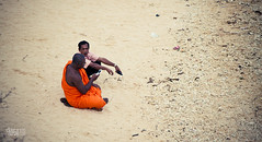 To teach a preacher (Daran Kandasamy) Tags: orange man beach mobile canon relax sand funny day phone fort preacher sunny monk pebbles 7d srilanka galle teach learn uncommon 24105mm