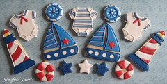 Nautical Baby Shower (Songbird Sweets) Tags: stars lighthouses nautical sailboats onesies babyshower sugarcookies lifesavers songbirdsweets captainswheels