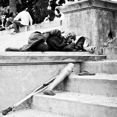 put your feet up and rest your weary leg... (photocillin) Tags: street sleep leg rest crutch prosthesis