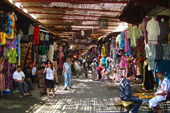 Souq, Fez, Morocco (Ferry Vermeer) Tags: shadow people color colour shopping clothing shadows northafrica ceiling textile morocco fez maroc shops marocco souk medina colored marketplace checkers textiles m