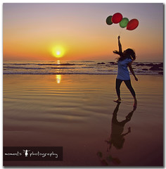fly away... (PNike (Prashanth Naik..back after ages)) Tags: sea sky woman sun india reflection beach water girl lady sunrise balloons fly jump sand nikon rocks asia vizag visakhapatnam d7000 pnike