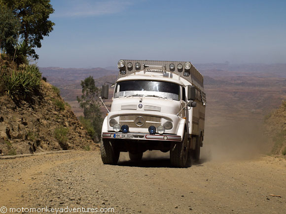 After a morning service at Lalibella main stone church, Dieter and Juliana take the lead and chug their massive tank of a truck back down the mountain to the main road. Pulling this old super truck through the mountains ranges at an average of 2500m ab...
