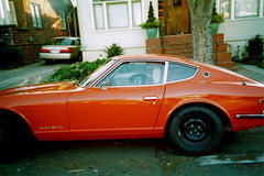 i c u (angela marlaud) Tags: orange dog film car 35mm berkeley lomo lomography datsun 240z