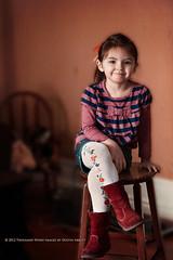 Spunky Cowgirl (Thousand Word Images by Dustin Abbott) Tags: portrait texture cowboy child boots bokeh naturallight depthoffield canonef85mmf18 alienskinexposure canoneos5dmkii kimklassen adobephotoshopcs5 thousandwordimages adobelightroom4