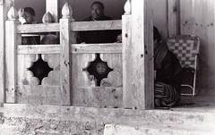 Peeping Tricks (sgrazied) Tags: blackandwhite bw film child bhutan east oriente himalaya freetibet biancoenero peeping bambino pellicola cameraoscura buddismo spiare sbirciare