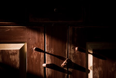 crooked little lie (winnie's human (all work and no play)) Tags: red mystery rust moody different shadows cabinet furniture chest off odd oddity drama crooked dramaticlighting offbalance closeddoors lateafternoonlig