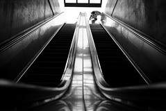 1up (maekke) Tags: urban bw woman reflection architecture stairs umbrella switzerland noiretblanc pov escalator streetphotography symmetry pointofview calatrava fujifilm zrich ch stadelhofen 2016 x100t