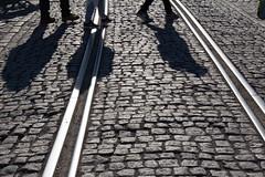 Crossing the tracks (KevPBur) Tags: people texture suomi finland spring helsinki track shadows tramlines setstones canon650d setpaving canonefs18135mmf3556isstm canonrebelt4i canonkissx6i canon650dcanonkissx6icanonrebelt4i