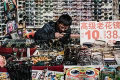 Untitle (Ruikexi) Tags: people man shop beijing hutong sell qianmen