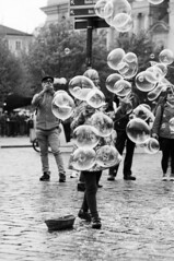 Bursting Bubbles (holtelars) Tags: street blackandwhite bw 120 film monochrome analog mediumformat 645 prague pentax streetphotography bubbles praha 200iso czechrepublic analogue 6x45 oldtownsquare czechia foma f35 pentax645 filmphotography rodinalspecial studional 150mm fomapan fomapan200 classicblackwhite 645n smcpentaxa homeprocessing fomapan200creative filmforever r09spezial larsholte compardr09spezial