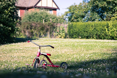 trike in a field (kevin.boyd) Tags: park shadow summer house canada field bike bicycle kids toy kid bc tricycle victoria gorge bushes depth waterway