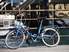 Parked (cyclingshepherd) Tags: blue portugal bike bicycle june fence pier stand rust lock rad rusty bicicleta rack frame farol algarve folder ilha velo fahrrad saddle combination whitewall olhao olho 2016