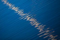Reflections, Sailboat mast (Mabry Campbell) Tags: blue abstract color reflection photography coast march photo skne europe sweden minimal coastal photograph 100 ripples sverige scandinavia simple malm f28 malmo 2012 200mm skane allreflection ef200mmf28liiusm westernharbor canonef200mmf28liiusm sec mabrycampbell 201203034346 march32012 colorripple ripleinwater whiteripple