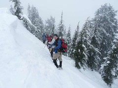 Heading off the summit in the snow