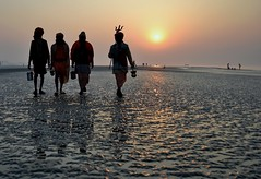 Life on The Beach......After The Holy Dip (pallab seth) Tags: morning india beach saint festival sunrise religious nikon religion culture tradition custom hindu hinduism bengal pilgrimage pilgrim ganga sadhu gettyimages 2012 holyman ganges mela sagar bayofbengal gangasagar holydip gangasagarmela blinkagain