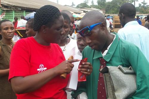 peer educators educate the market vendors on condom use