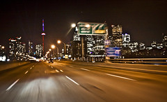 Flying down the Gardiner 7/52 - Explored!! (jrobblee) Tags: road street light signs toronto motion blur tower cars car night cn canon project dark eos movement highway driving cntower vehicles nighttime gardiner roads 52 roadway february15 week7 50d week07 52project 52of2012